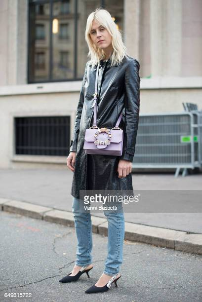 Linda Tol poses wearing Dior shoes and a Miu Miu bag after the Miu Miu show at the Palais de Iena during Paris Fashion Week Womenswear FW 17/18 on...