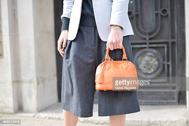 Linda Tol poses wearing LK Bennet jacket Uniqlo top Dries Van Noten pants and Louis Vuitton bag on Day 5 of Paris Fashion Week Womenswear on March 7...