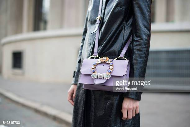 Linda Tol poses with a Miu Miu bag after the Miu Miu show at the Palais de Iena during Paris Fashion Week Womenswear FW 17/18 on March 7 2017 in...