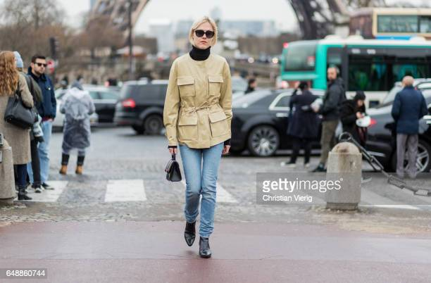 Linda Tol wearing a beige jacket denim jeans outside Hermes on March 6 2017 in Paris France