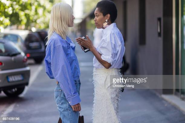 Linda Tol wearing a blue white striped button shirt denim jeans and Tamu McPherson is seen outside MSGM during Milan Men's Fashion Week Spring/Summer...