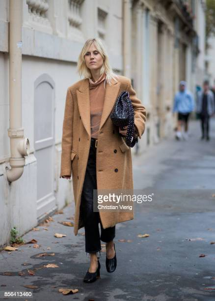 Linda Tol wearing a brown coat seen outside Valentino during Paris Fashion Week Spring/Summer 2018 on October 1 2017 in Paris France