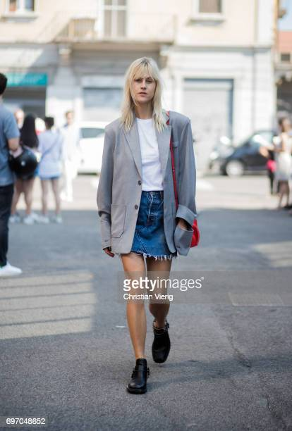 Linda Tol wearing a denim mini skirt grey blazer white tshirt boots is seen outside Diesel during Milan Men's Fashion Week Spring/Summer 2018 on June...