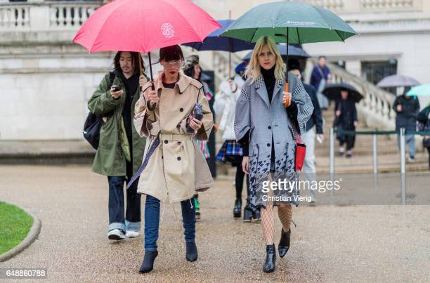 Linda Tol wearing a grey coat outside Sacai on March 6 2017 in Paris France