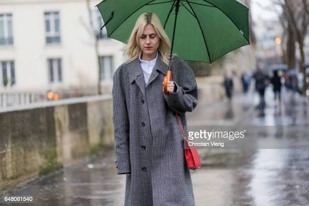 Linda Tol wearing a grey vintage coat outside Mugler on March 4 2017 in Paris France