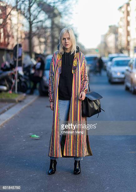 Linda Tol wearing a mulit color striped coat black bag black hoody at Etro during Milan Men's Fashion Week Fall/Winter 2017/18 on January 16 2017 in...