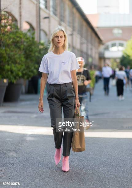 Linda Tol wearing a white tshirt denim jeans pink boots brown bag is seen outside Malibu 1992 during Milan Men's Fashion Week Spring/Summer 2018 on...