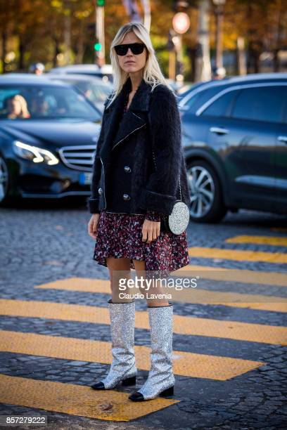 Linda Tol wearing yellow jacket cropped top and a skirt is seen before the Chanel show during Paris Fashion Week Womenswear SS18 on October 3 2017 in...