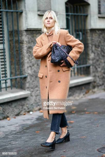 Linda Tol wears a beige coat outside Valentino during Paris Fashion Week Womenswear Spring/Summer 2018 on October 1 2017 in Paris France