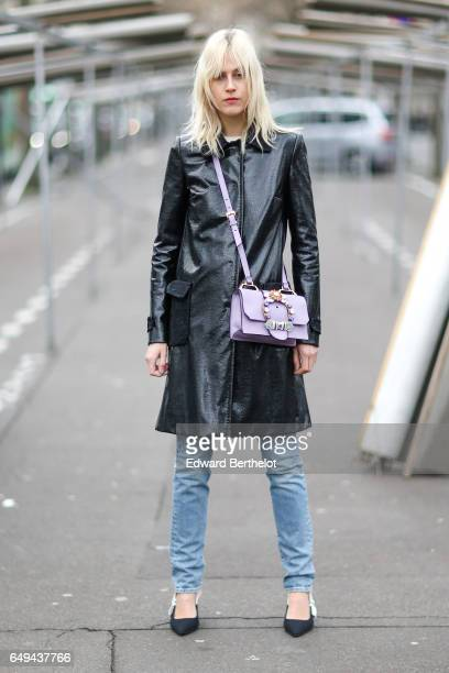 Linda Tol wears a black leather jacket blue jeans and a pink bag outside the Ellery show during Paris Fashion Week Womenswear Fall/Winter 2017/2018...