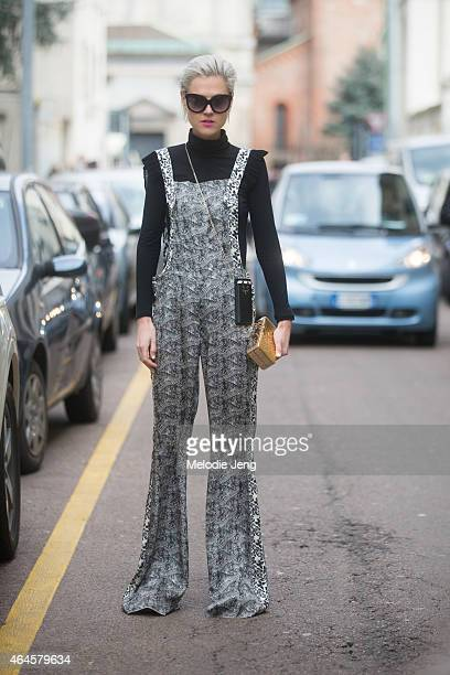 Linda Tol wears a Just Cavalli dress Zagliani clutch and Charlotte Olympia phone case on February 26 2015 in Milan Italy