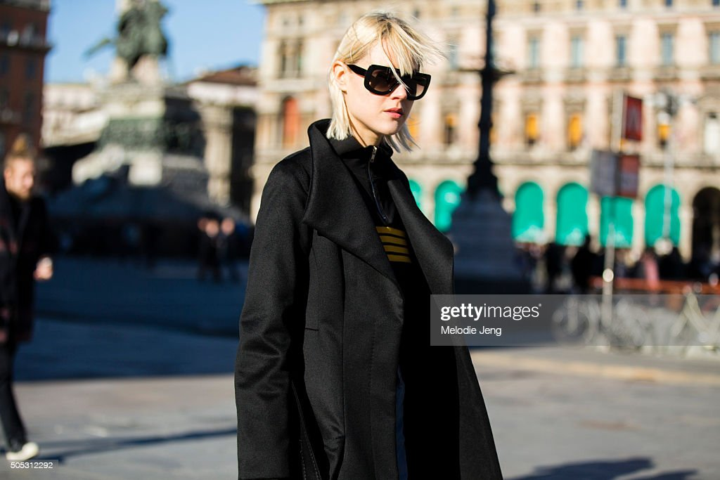 Linda Tol wears a Max Mara coat, black and yellow Ganni zip-stripe jacket, and Celine sunglasses during the Milan Men's Fashion Week Fall/Winter 2016/17 on January 16, 2016 in Milan, Italy.