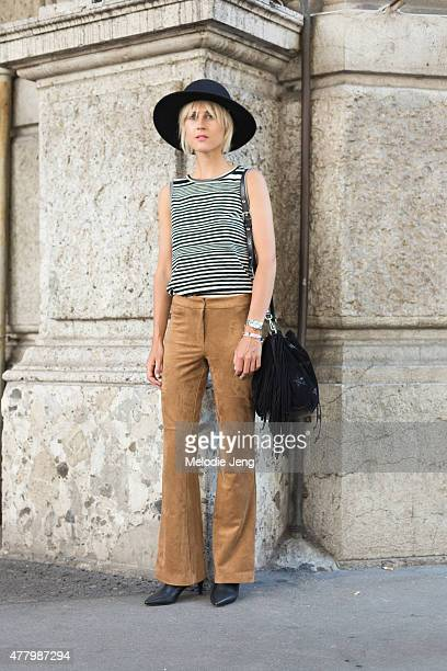 Linda Tol wears a Missoni top and HM pants poses during Milan Men's Fashion Week Spring/Summer 2016 on June 20 2015 in Milan Italy