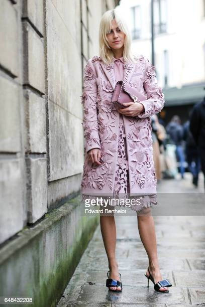 Linda Tol wears a pink jacket a pink dress and pink Valentino rockstud bag outside the Valentino show during Paris Fashion Week Womenswear...