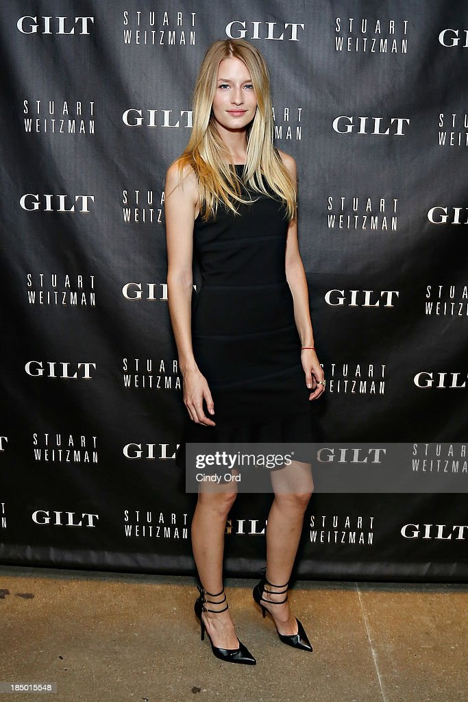 <a gi-track='captionPersonalityLinkClicked' href=/galleries/search?phrase=Linda+Vojtova&family=editorial&specificpeople=856705 ng-click='$event.stopPropagation()'>Linda Vojtova</a> attends as Gilt And Stuart Weitzman celebrate the 5050 Boot 20th anniversary on October 16, 2013 in New York City.