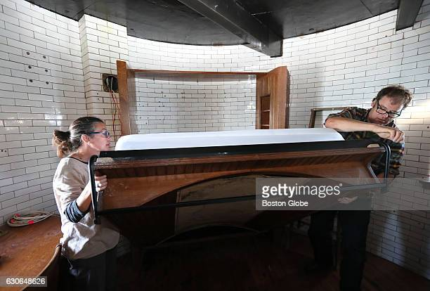 Linda Waller and Dave Waller pull a Murphy bed built to curve with the wall of Graves Light a historic lighthouse in Boston Harbor on Oct 7 2016 Dave...