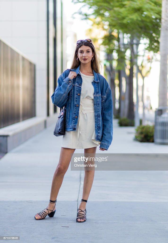 Linda wearing a denim jacket, wite dress, sandals on April 21, 2017 in Los Angeles, California.