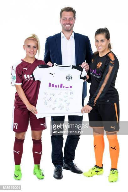 Linda Weiss and Marina Hegering of SGS Essen pose with Allianz Insurance Manager Bjoern Bartnick during the Allianz Frauen Bundesliga Club Tour at...