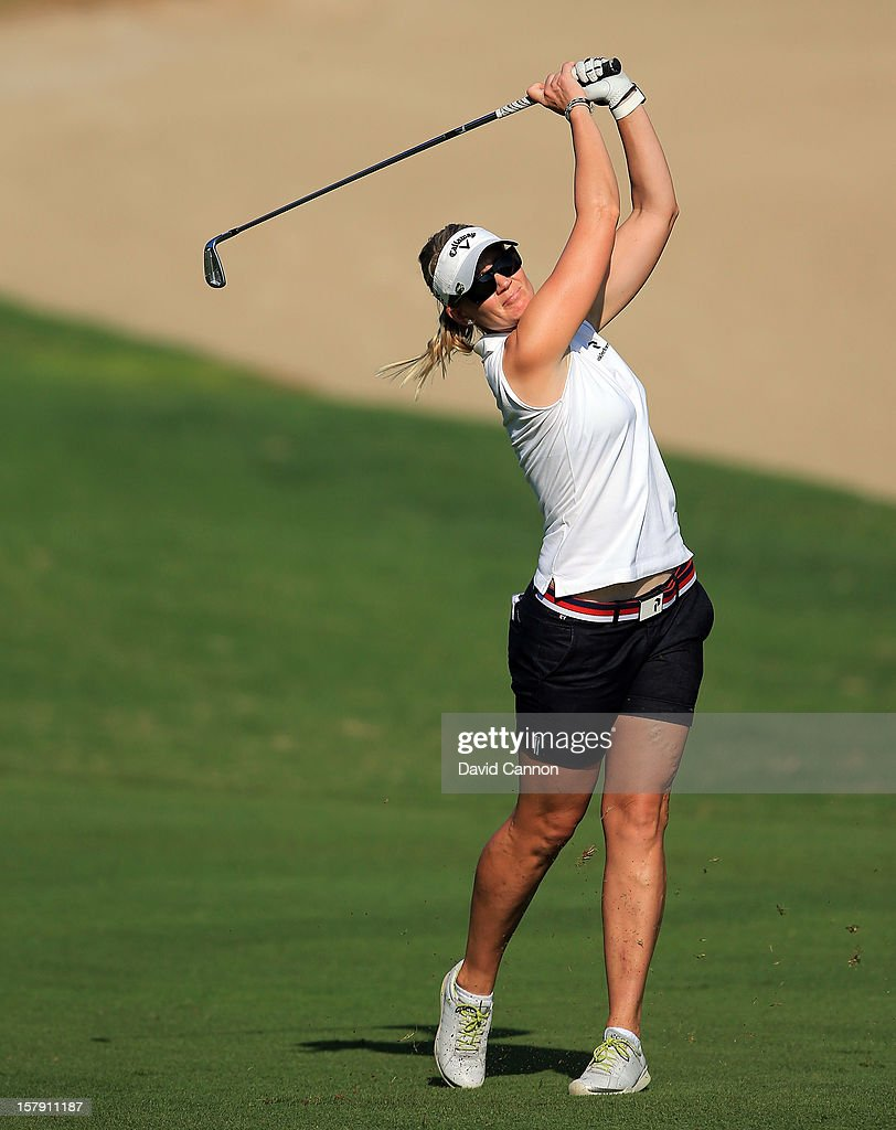 Linda Wessberg of Sweden plays her second shot at the par 4, 14th hole during the third round of the 2012 Omega Dubai Ladies Masters on the Majilis Course at the Emirates Golf Club on December 7, 2012 in Dubai, United Arab Emirates.