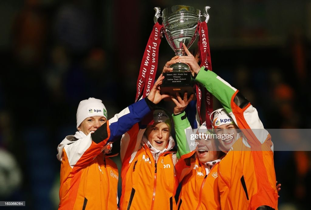 Linde de Vries, Diane Valkenburg, Ireen Wust and Marrit Leenstra of the Netherlands celebrate with their trophy after winning the team pursuit race of the women Speed Skating World Cup at the Thialf stadium in Heerenveen, on March 8, 2013.