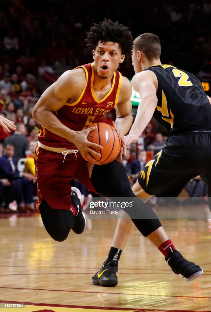Lindell Wigginton #5 of the Iowa State Cyclones drives the ball past Jack Nunge #2 of the Iowa Hawkeyes in the first half of play at Hilton Coliseum on December 7, 2017 in Ames, Iowa.