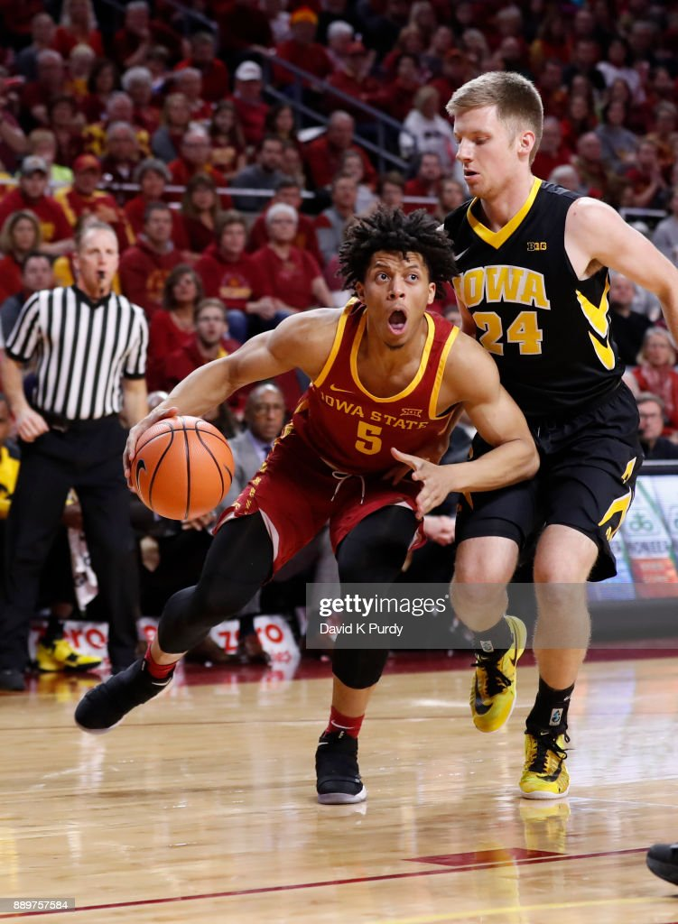 Lindell Wigginton #5 of the Iowa State Cyclones drives the ball past Brady Ellingson #24 of the Iowa Hawkeyes in the first half of play at Hilton Coliseum on December 7, 2017 in Ames, Iowa.