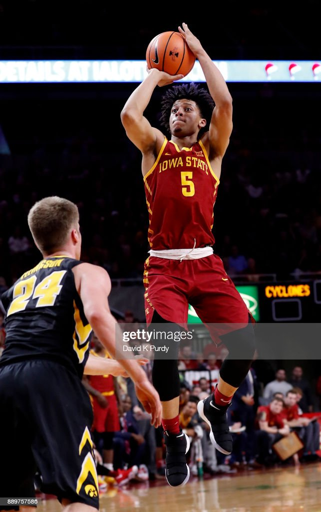 Lindell Wigginton #5 of the Iowa State Cyclones takes a shot as Brady Ellingson #24 of the Iowa Hawkeyes defends in the first half of play at Hilton Coliseum on December 7, 2017 in Ames, Iowa.