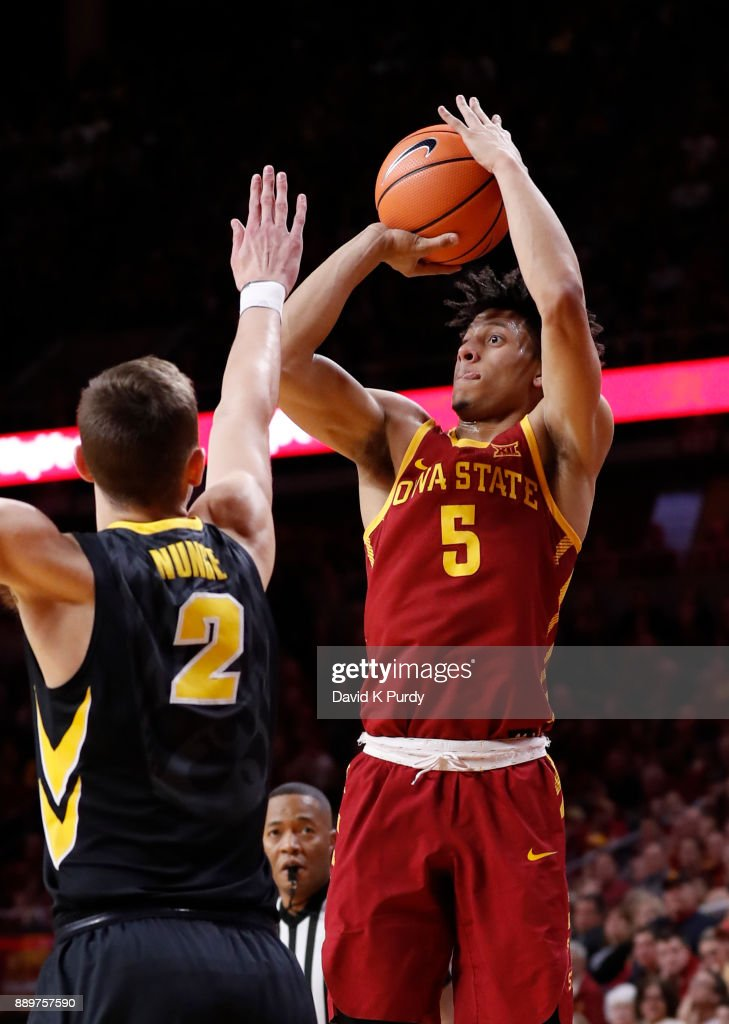 Lindell Wigginton #5 of the Iowa State Cyclones takes a shot as Jack Nunge #2 of the Iowa Hawkeyes defends in the first half of play at Hilton Coliseum on December 7, 2017 in Ames, Iowa.