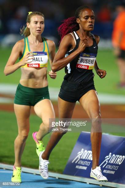 Linden Hall of Australia and Selah Buslenei of Kenya competes in the Women's 1 Mile Elimation during Nitro Athletics at Lakeside Stadium on February...