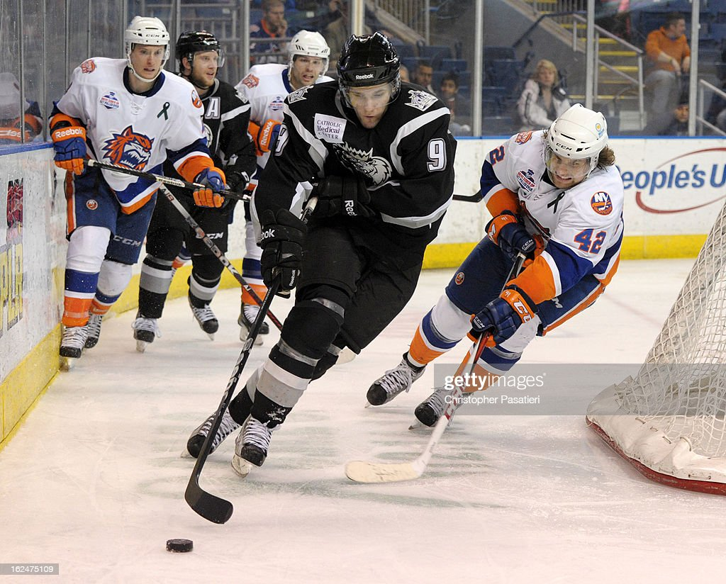 Linden Vey #9 of the Manchester Monarchs skates with the puck against Brandon DeFazio #42 of the Bridgeport Sound Tigers during an American Hockey League game on February 23, 2013 at the Webster Bank Arena at Harbor Yard in Bridgeport, Connecticut.