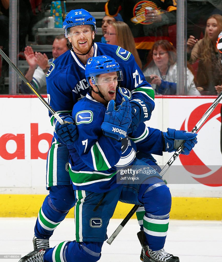 <a gi-track='captionPersonalityLinkClicked' href=/galleries/search?phrase=Linden+Vey&family=editorial&specificpeople=4754188 ng-click='$event.stopPropagation()'>Linden Vey</a> #7 of the Vancouver Canucks celebrates his first NHL goal with teammate <a gi-track='captionPersonalityLinkClicked' href=/galleries/search?phrase=Daniel+Sedin&family=editorial&specificpeople=202492 ng-click='$event.stopPropagation()'>Daniel Sedin</a> #22 during their NHL game against the Edmonton Oilers at Rogers Arena October 11, 2014 in Vancouver, British Columbia, Canada. Vancouver won 5-4 in a shootout.