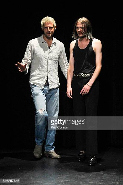 Linder designers Sam Linder and Kirk Millar pose for photographers during the Linder Presentation at Dixon Place on July 11 2016 in New York City