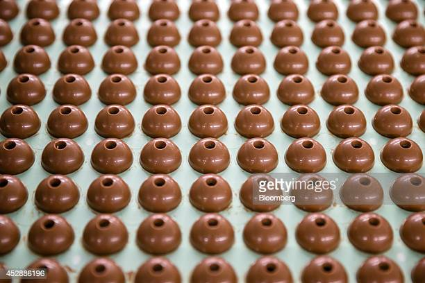 Lindor chocolate balls sit on the production line inside the Lindt Spruengli AG factory in Kilchberg Switzerland on Tuesday July 29 2014 Lindt the...