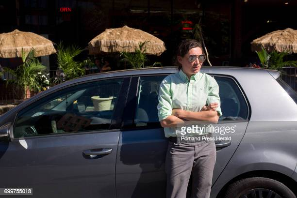 Lindsay Carter outside of her car on Federal street Carter works in paint sales and often pulls over when she has to take calls when she is on the...