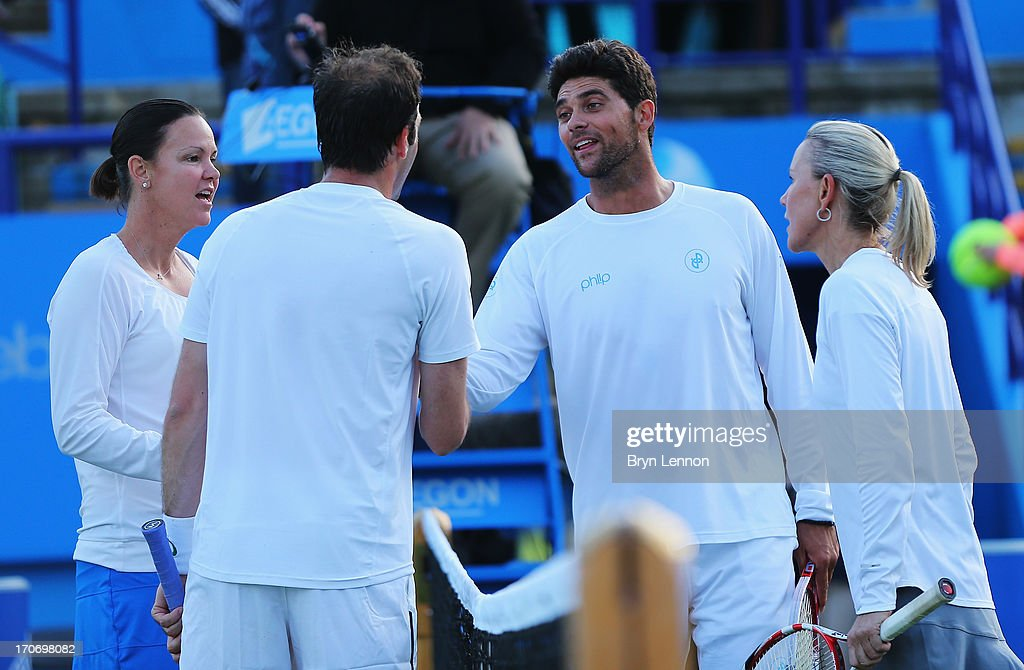 <a gi-track='captionPersonalityLinkClicked' href=/galleries/search?phrase=Lindsay+Davenport&family=editorial&specificpeople=201764 ng-click='$event.stopPropagation()'>Lindsay Davenport</a> of USA and partner <a gi-track='captionPersonalityLinkClicked' href=/galleries/search?phrase=Greg+Rusedski&family=editorial&specificpeople=201807 ng-click='$event.stopPropagation()'>Greg Rusedski</a> of Great Britain congratulate <a gi-track='captionPersonalityLinkClicked' href=/galleries/search?phrase=Mark+Philippoussis&family=editorial&specificpeople=162774 ng-click='$event.stopPropagation()'>Mark Philippoussis</a> and his partner <a gi-track='captionPersonalityLinkClicked' href=/galleries/search?phrase=Rennae+Stubbs&family=editorial&specificpeople=217316 ng-click='$event.stopPropagation()'>Rennae Stubbs</a> of Australia after their mixed doubles exhibition legends match during day two of the AEGON International tennis tournament at Devonshire Park on June 16, 2013 in Eastbourne, England.