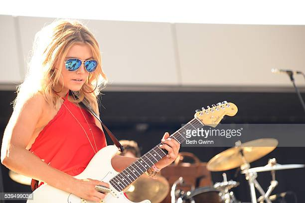 Lindsay Ell performs on the Bobby Bones show during CMA Festival on the Ascend Stage on June 11 2016 in Nashville Tennessee