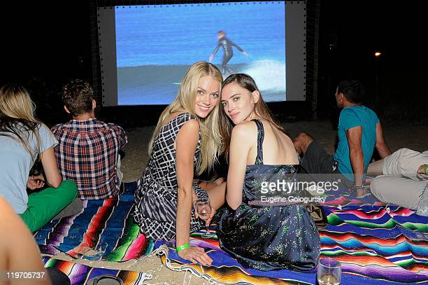 Lindsay Ellingson and Rachel Alexander attend the Tommy Hilfiger presentation of a screening of Sight Sound a surf film by Mickey DeTemple at The...