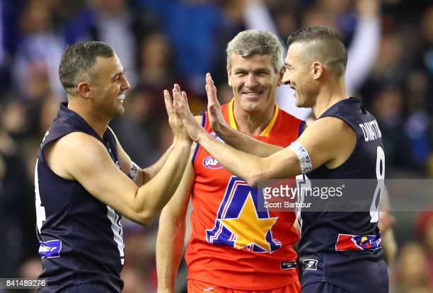 Lindsay Gilbee of Victoria is congratulated by Paul Dimattina of Victoria after kicking a super goal during the 2017 EJ Whitten Legends Game between...
