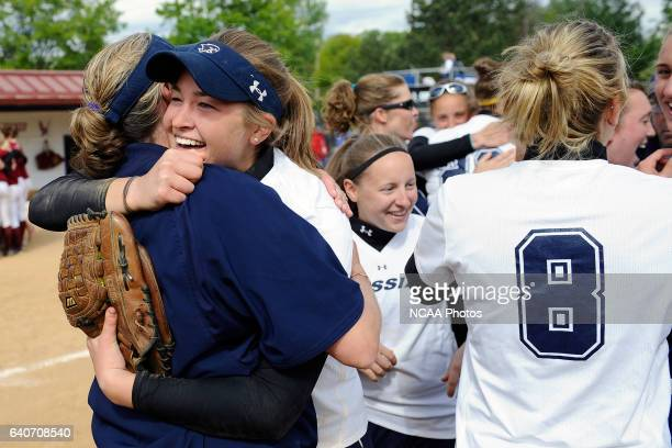 Lindsay Hall celebrates with her teammates after Messiah clinched the national championship during the Division III Women's Softball Championship...