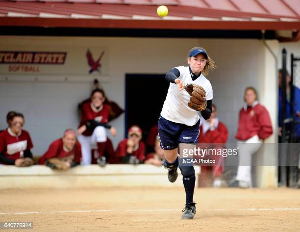 Lindsay Hall of Messiah College throws out Amanda Hanson of Coe College in the sixth inning of the Division III Women's Softball Championship held at...