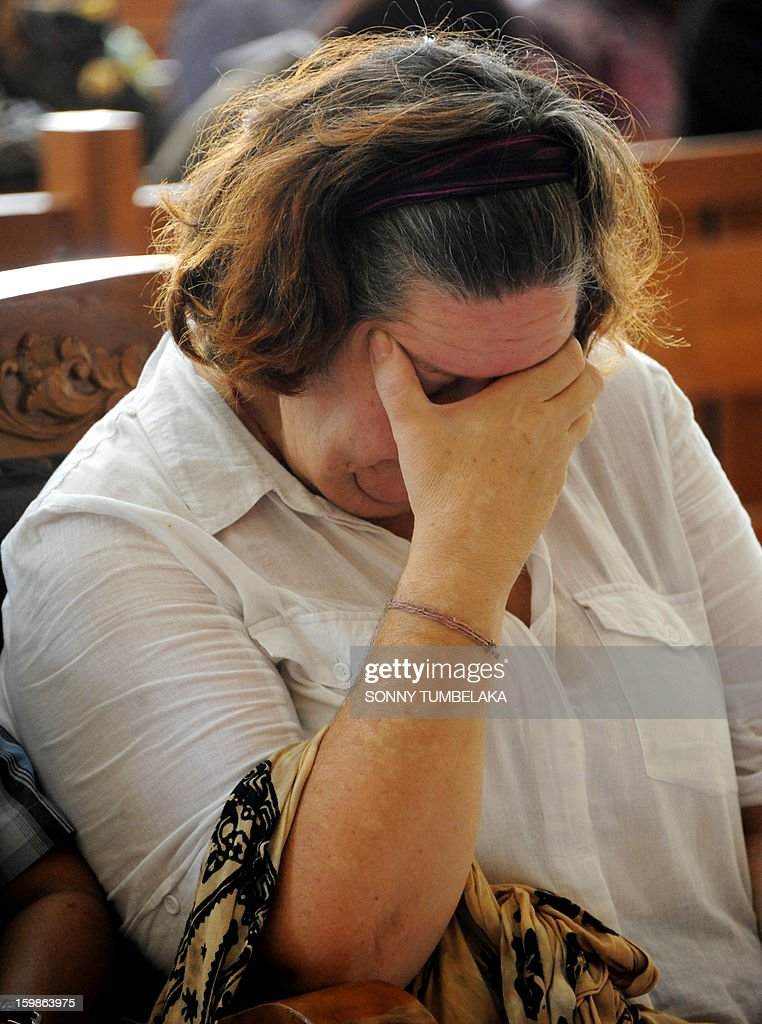 Lindsay June Sandiford of Britain covers her face as she attends her trial at a court in Denpasar on the Indonesian resort island of Bali on January 22, 2013. An Indonesian court on January 22 sentenced 56-year-old Sandiford to death for smuggling cocaine into the resort island of Bali.