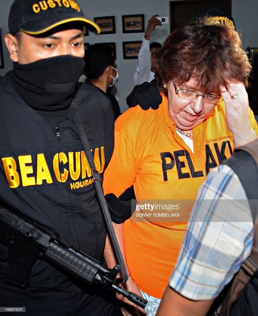 Lindsay June Sandiford (R), 56, of Britain is escorted by a armed customs personnel at a customs office in Denpasar on Bali island on May 28, 2012. Sandiford was arrested on May 19 carrying 4.7 kilogramms of cocaine in her luggage at Bali International Airport in Indonesia, official said. If convicted of smuggling the drugs into Indonesia, the England could face the death penalty.