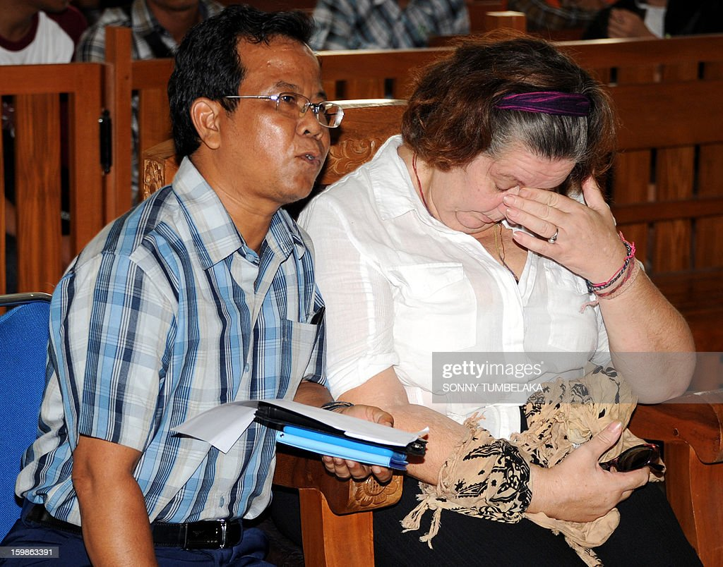 Lindsay June Sandiford (R) of Britain reacts as she attends her trial at a court in Denpasar on the Indonesian resort island of Bali on January 22, 2013. An Indonesian court on January 22 sentenced a 56-year-old British grandmother to death for smuggling cocaine into the resort island of Bali.