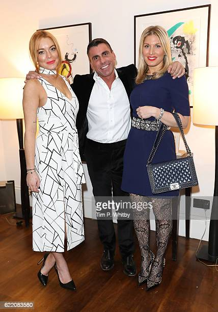 Lindsay Lohan Alessandro GrassiniGrimaldi and Hofit Golan attend an afternoon tea hosted by Damiani in aid of Nadedza Foundation at Morton's Club on...