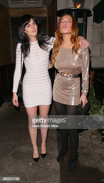 Lindsay Lohan and Ali Lohan attending the LOVE x Balmain Chrismas Party at The Ivy Market Grill on December 15 2014 in London England
