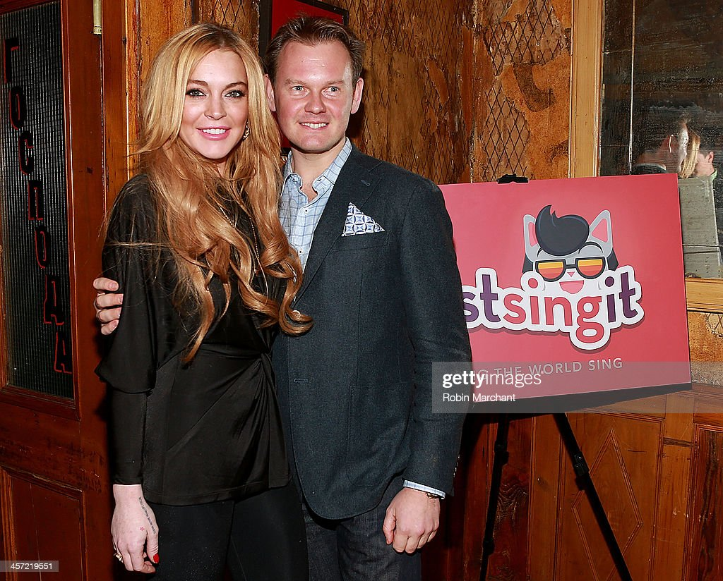<a gi-track='captionPersonalityLinkClicked' href=/galleries/search?phrase=Lindsay+Lohan&family=editorial&specificpeople=171623 ng-click='$event.stopPropagation()'>Lindsay Lohan</a> and Foundation CEO Alec Andronikov attend the 'Just Sing It' app launch event at Pravda on December 16, 2013 in New York City.