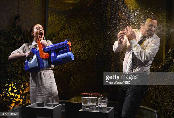 Lindsay Lohan and Jimmy Fallon play a game of 'Water War' during a taping of 'The Tonight Show Starring Jimmy Fallon' at Rockefeller Center on March...