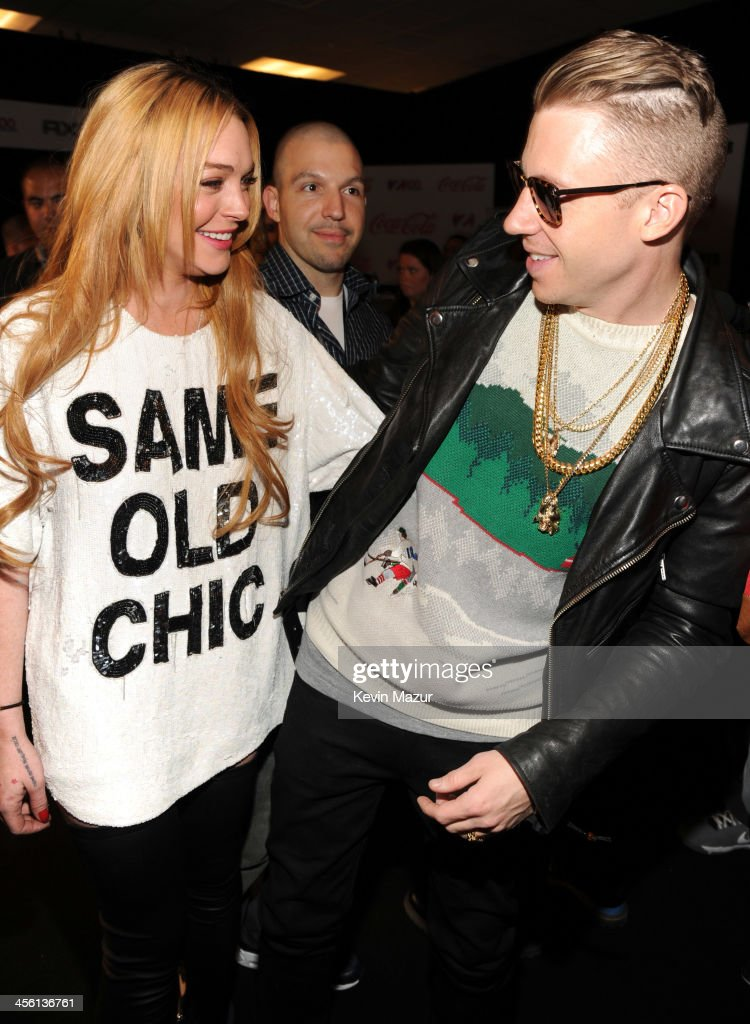 Lindsay Lohan and Macklemore attend the Z100's Artist Gift Lounge presented by AXE at Z100's Jingle Ball 2013 at Madison Square Garden on December 13, 2013 in New York City.