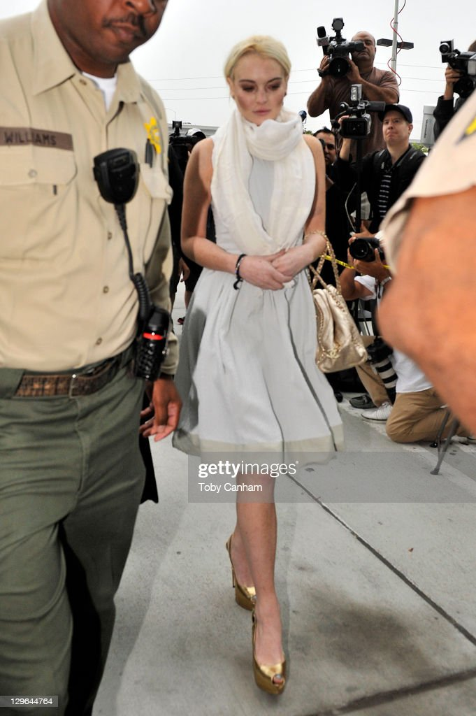 <a gi-track='captionPersonalityLinkClicked' href=/galleries/search?phrase=Lindsay+Lohan&family=editorial&specificpeople=171623 ng-click='$event.stopPropagation()'>Lindsay Lohan</a> arrives at her probation progress report hearing at the Airport Courthouse on October 19, 2011 in Los Angeles, California. Lohan was recently reassigned by her probation officer to community service with the American Red Cross after being terminated by the Downtown Women's Center for repeatedly failing to appear. Lohan was sentenced 360 hours of community service at the Downtown Women's Center and 120 hours at the L.A. County coroner's office stemming from a 2007 drunk-driving conviction and a jewelry theft conviction earlier this year.