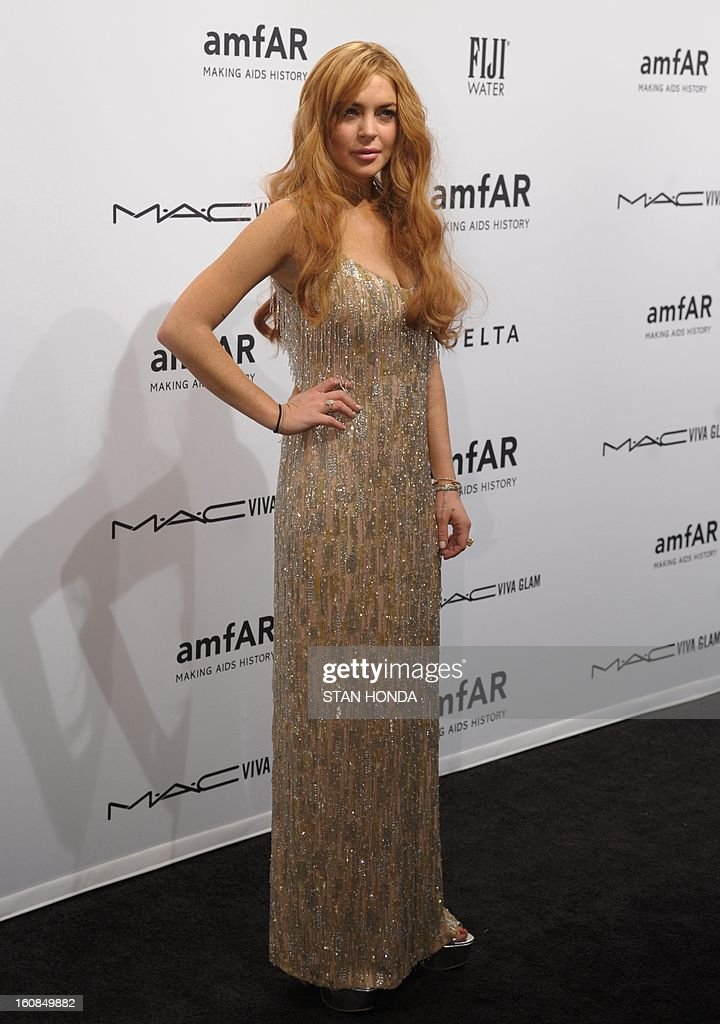 Lindsay Lohan arrives at the amfAR (The Foundation for AIDS Research) gala that kicks off the Mercedes-Benz Fashion Week February 6, 2013 in New York. AFP PHOTO/Stan HONDA